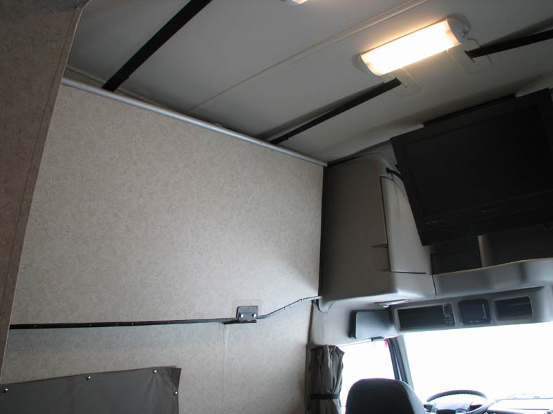 Cab lounge upper bunk folds out and out of the way