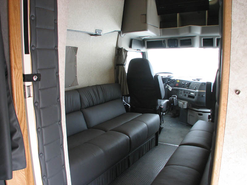 Cab coaches lounge area with fold down sofas