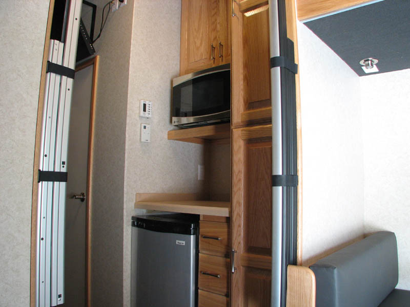 Kitchenette fridge microwave and storage