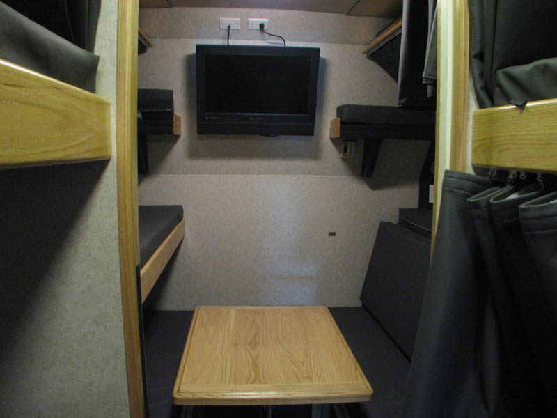 Rear lounge area with large wall TV as well as bunk TV,s to use when this area is converted into 6 beds