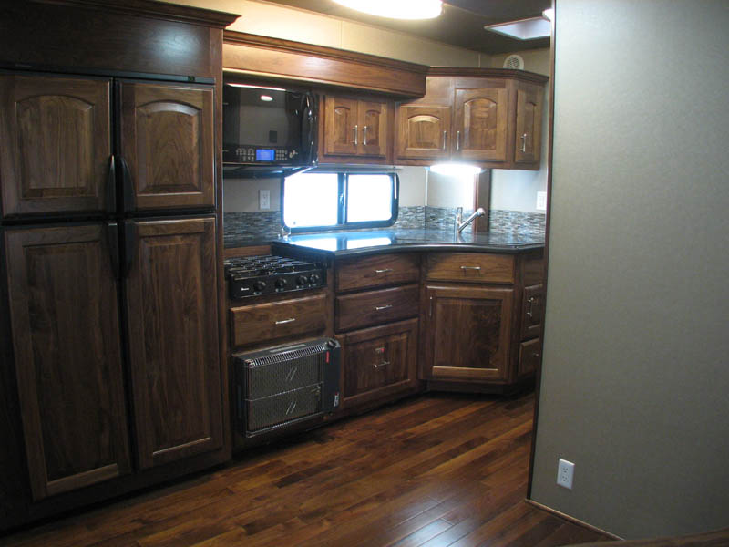 4 door fridge freezer, burner top, dish washer, granite countertops, true convection microwave, and cateletic heater (All Black Walnut very rich looking)