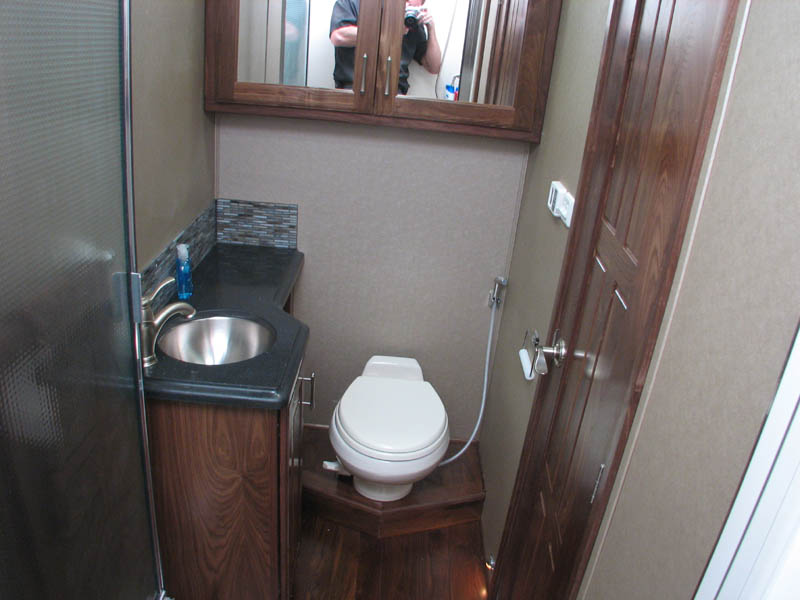 Toilet, sink, and shower located driver's side of the hallway